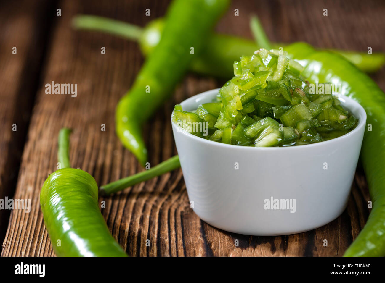 Green Chilis preserved in fresh native olive oil - Stock Image