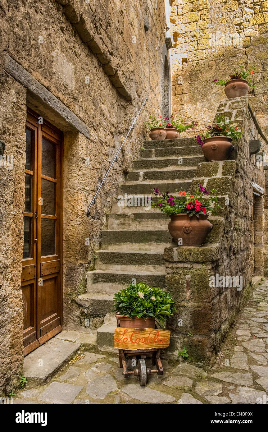 Ascending stone steps to dwelling in Civita di Bagnoregio, Italy - Stock Image