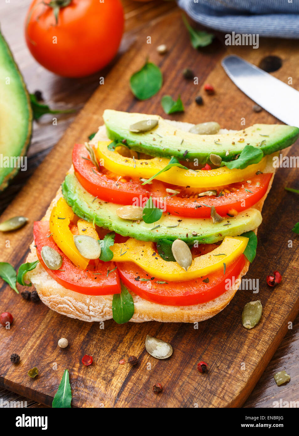 Vegetarian avocado sandwich with tomato and paprika - Stock Image