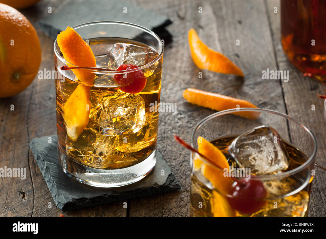 Homemade Old Fashioned Cocktail with Cherries and Orange Peel - Stock Image