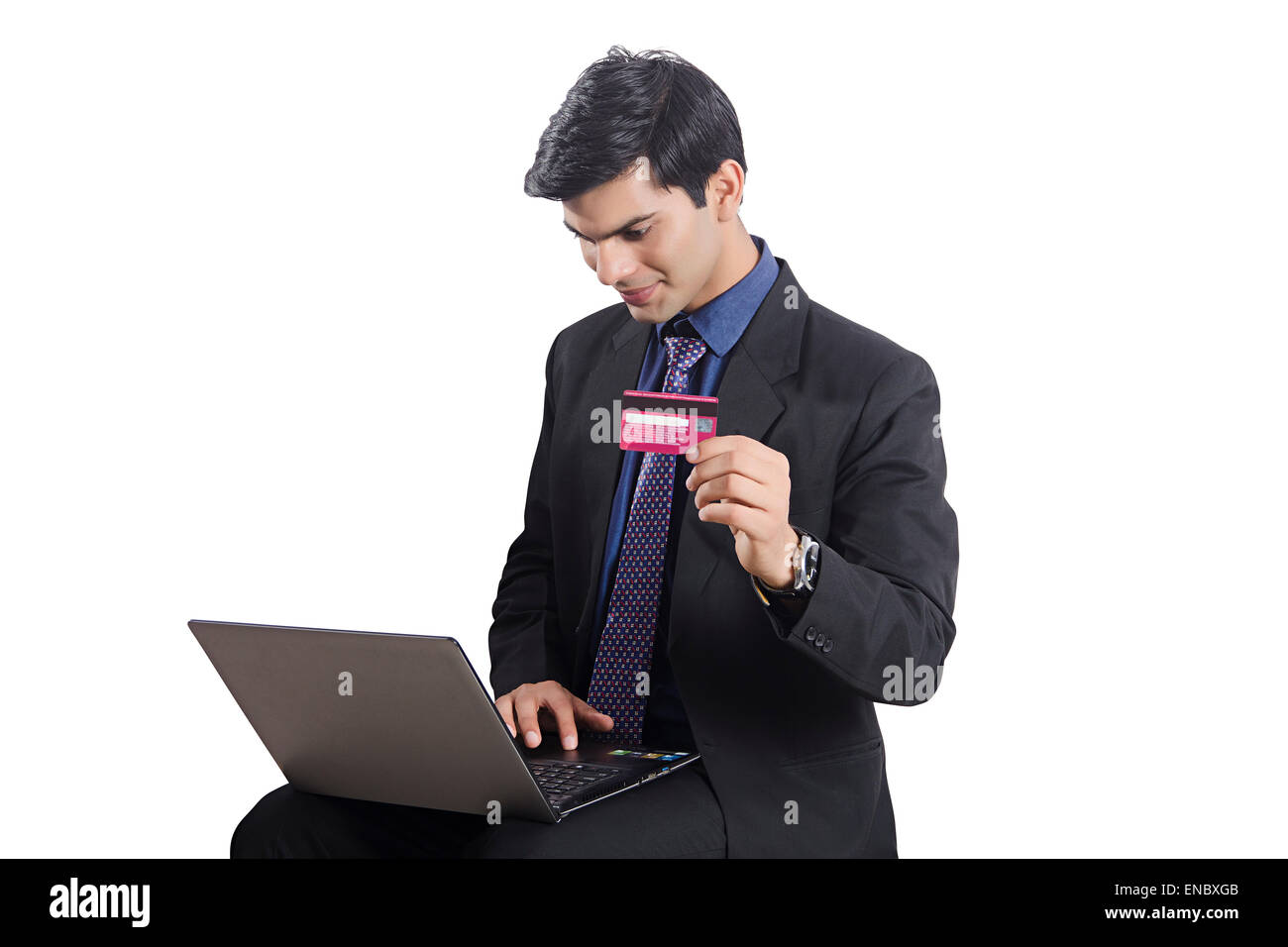 1 indian Business Man laptop Credit Card shopping - Stock Image