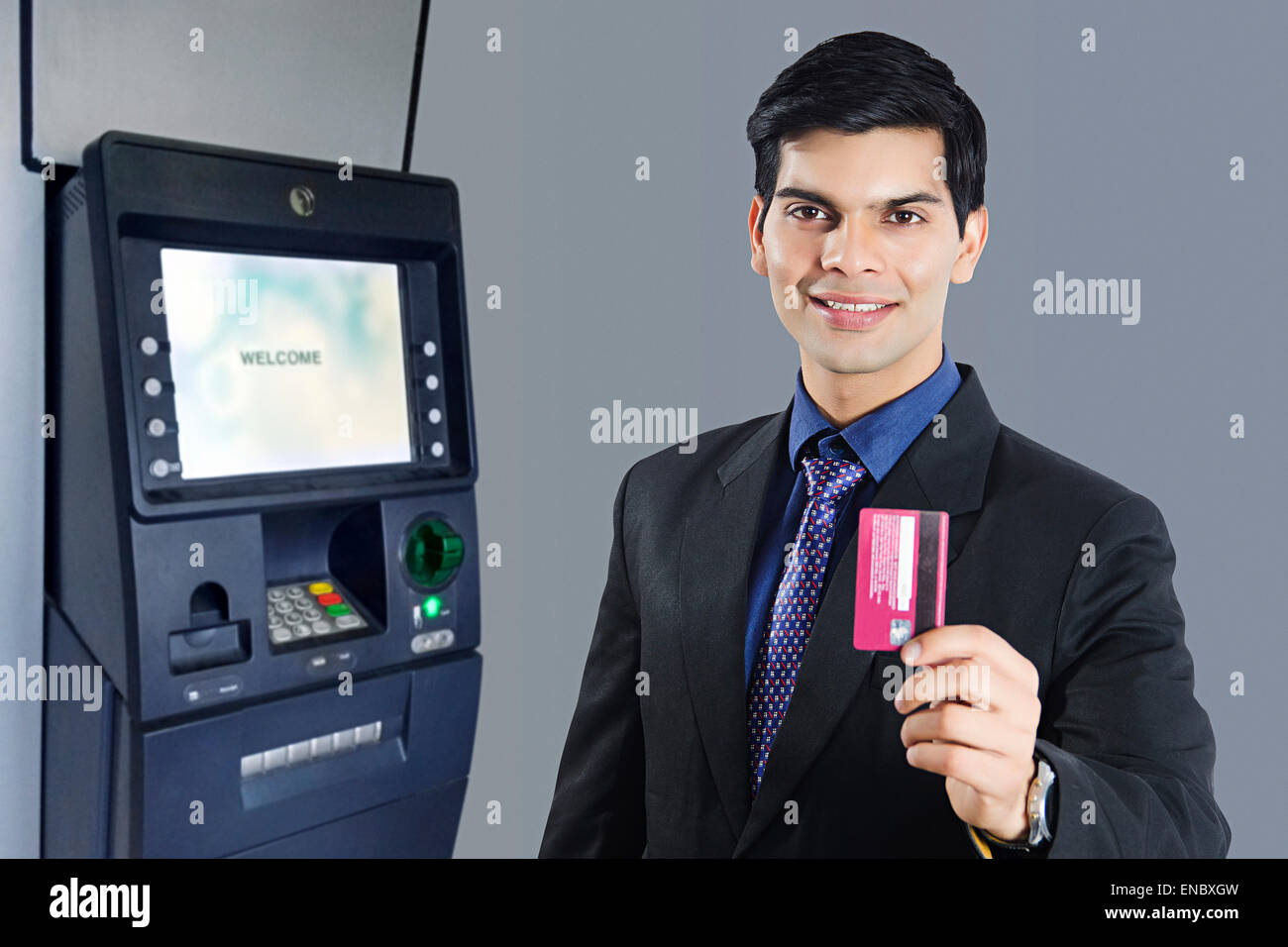 1 indian business man atm machine with credit card withdrawal stock 1 indian business man atm machine with credit card withdrawal reheart Images
