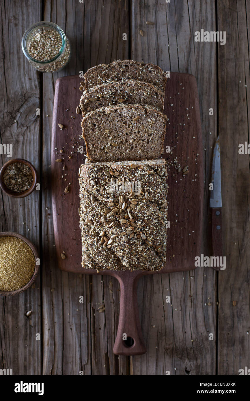 Millet and Buckweat Bread right after it came out of the oven displayed on a farm table. - Stock Image