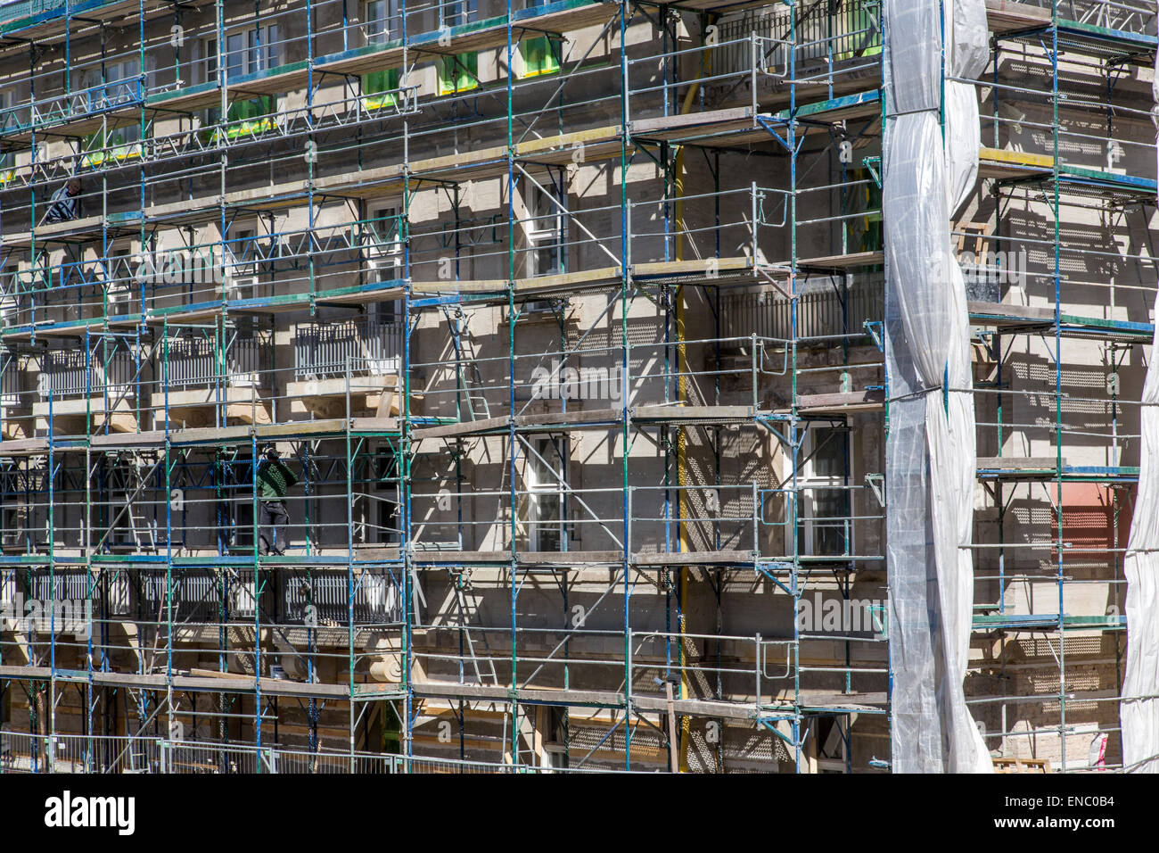 Renovation of a building surrounded by scaffolding, Berlin, Germany, - Stock Image