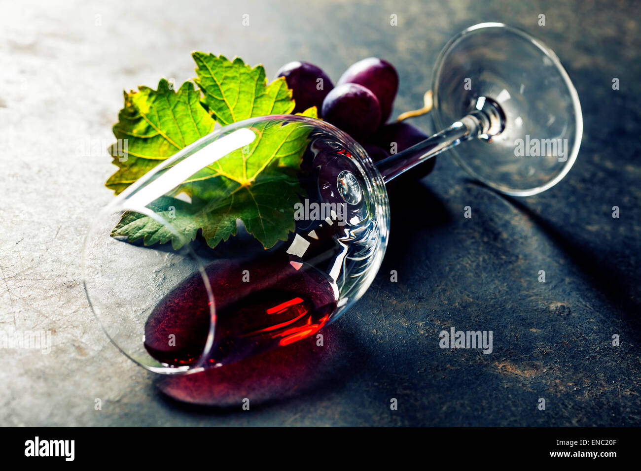 Glass of red wine on dark background - Stock Image