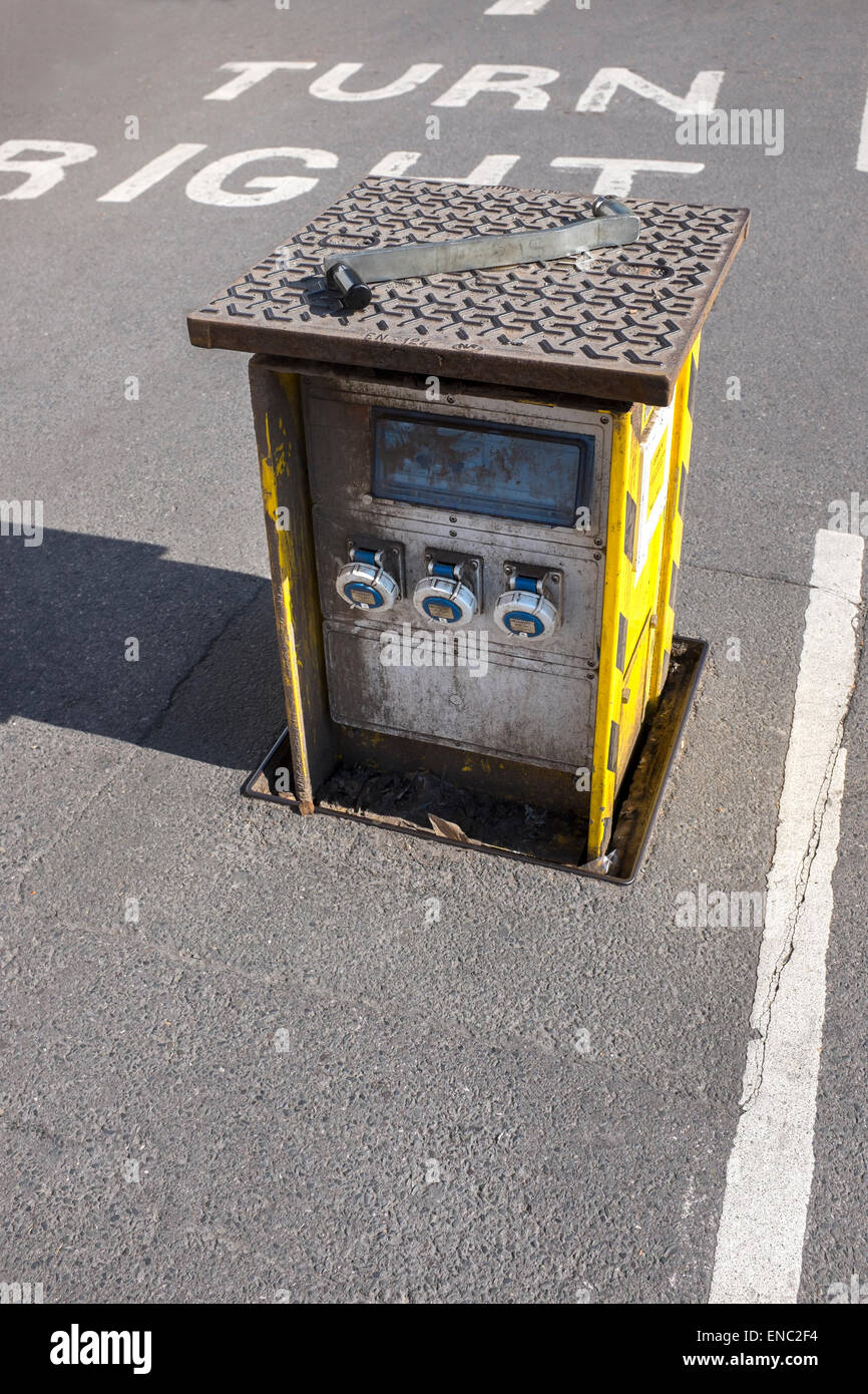 Sunken Electricity Power outlet in Car Park for Market Traders - Stock Image