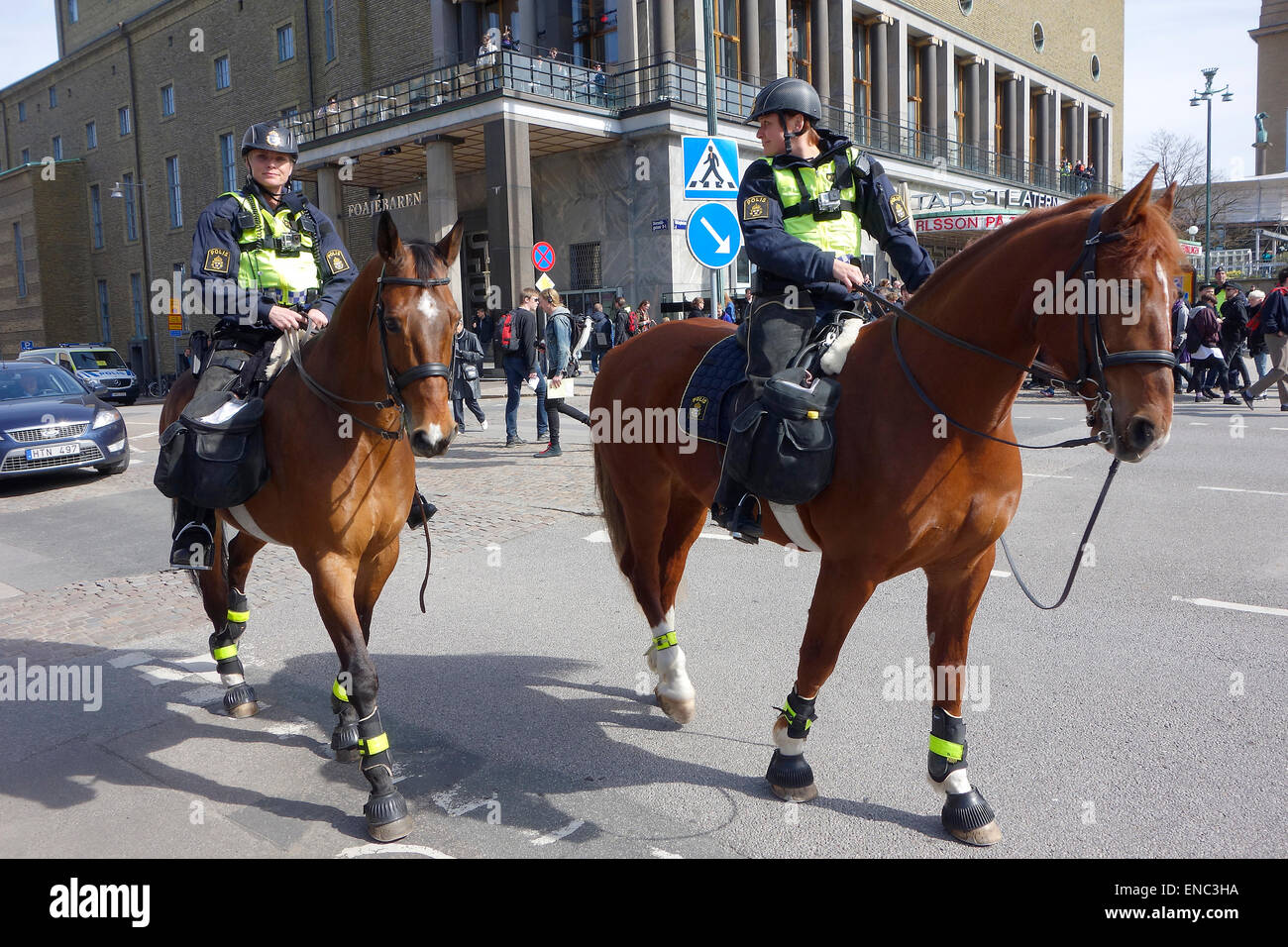 Two mounted female Swedish police officers patrolling on the street of Gothenburg city, Sweden - Stock Image