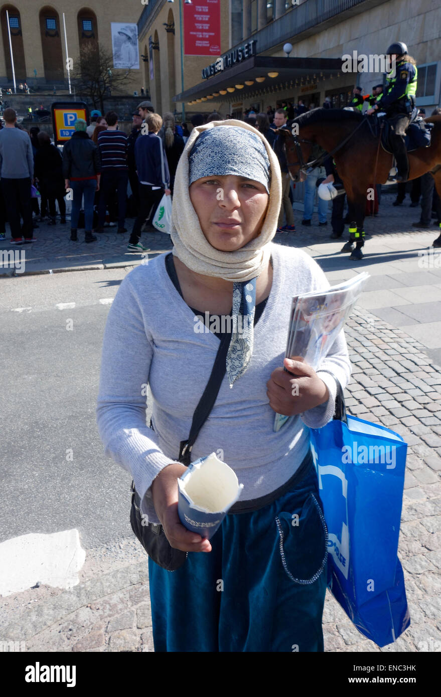 Young Roma woman begs for alms on the street of Gothenburg, Sweden Stock Photo