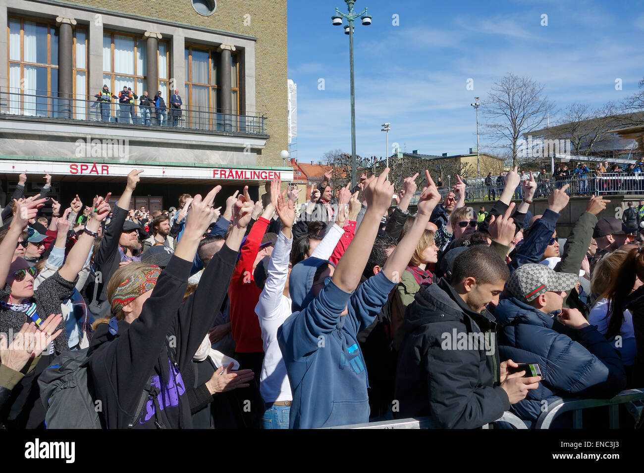 Protesting crowd, far-left counter-demonstrators, showing 'middle finger' - Stock Image