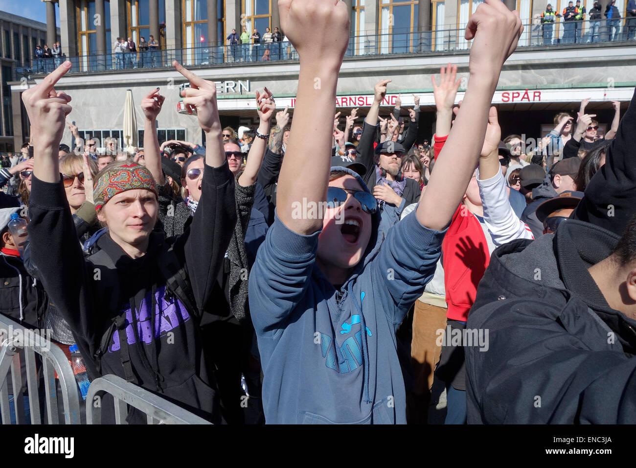 Protesting crowd, counter-demonstrators showing middle finger during PEGIDA demonstrations against islamisation - Stock Image