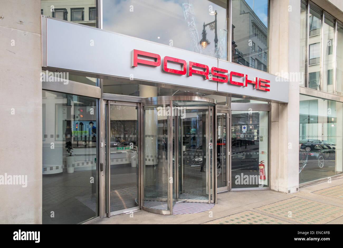 Entrance to and frontage of the modern Porsche showroom in Berkeley Square in the West End of London W1, England, - Stock Image