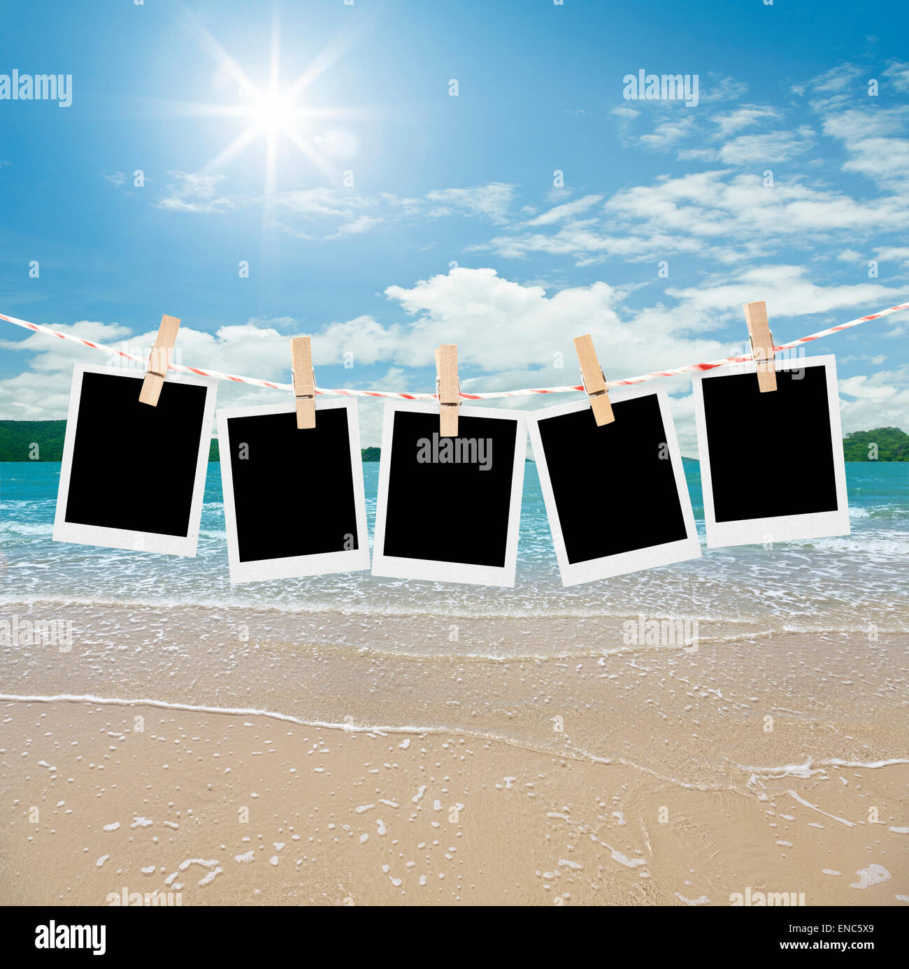 empty five photos hanging on beach - Stock Image
