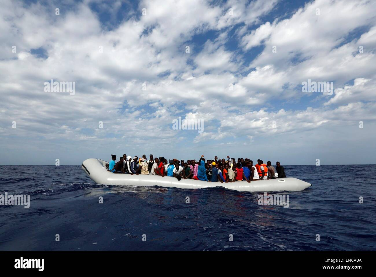 HANDOUT - A handout picture made available on 02 May 2015 shows 105 refugees on a rubber raft waiting to board the - Stock Image