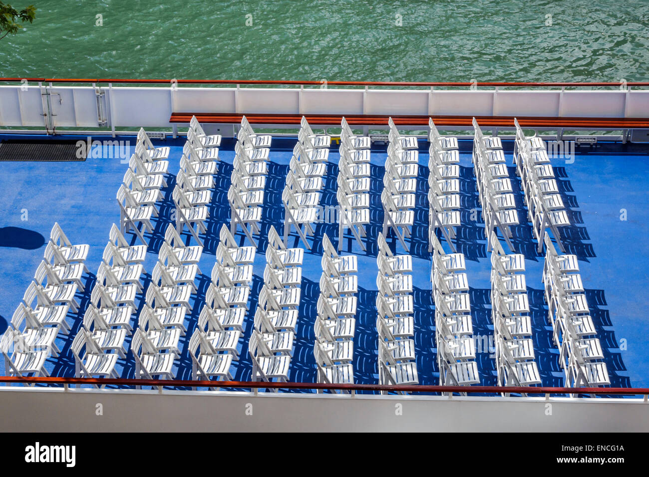 Chicago Illinois Chicago River boat tour boat upper deck chairs rows organized align water blue white empty - Stock Image