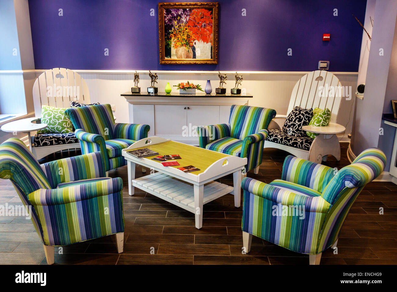 Chicago Illinois Gold Coast Historic District Hotel Indigo boutique hotel blue hue lobby seating chair stripe tile - Stock Image