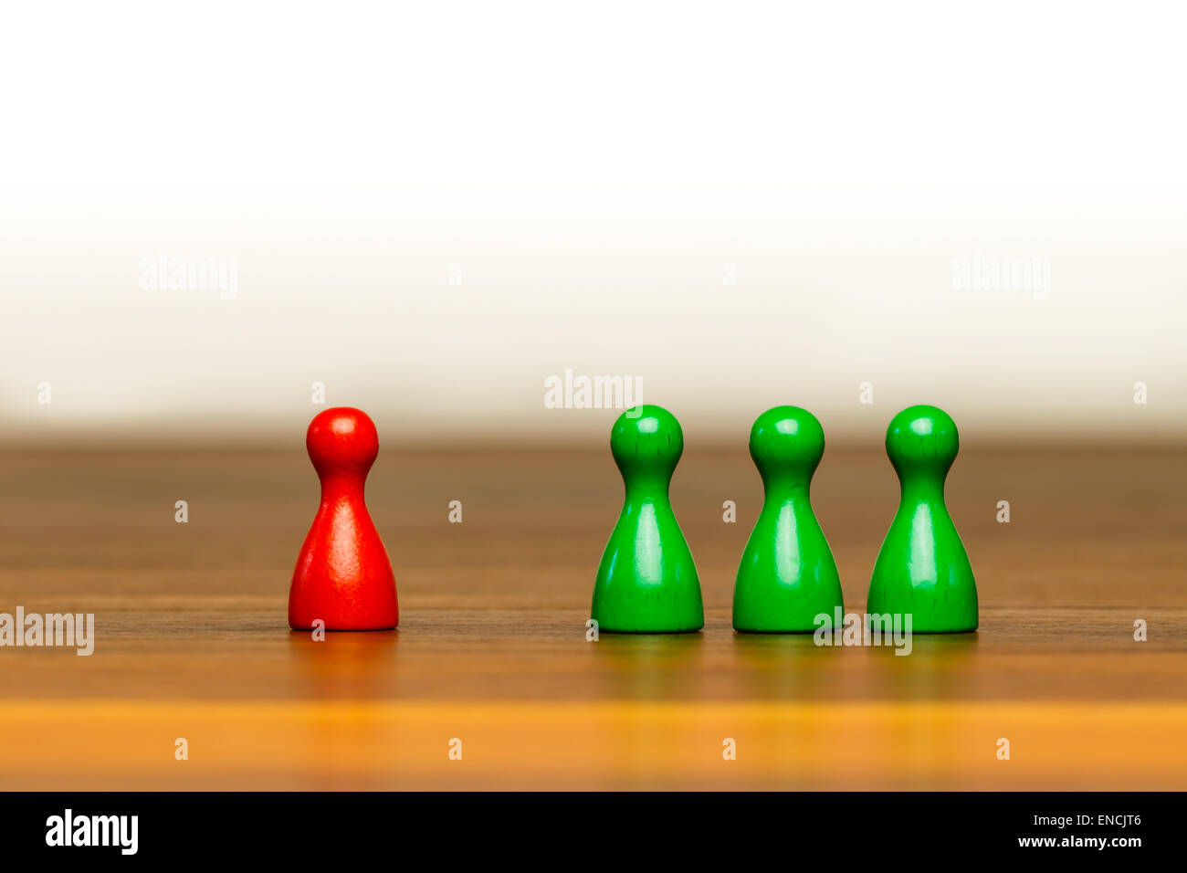Concept for: good or bad, isolation, confrontation, competition and difference. With colorful red and green pawn - Stock Image