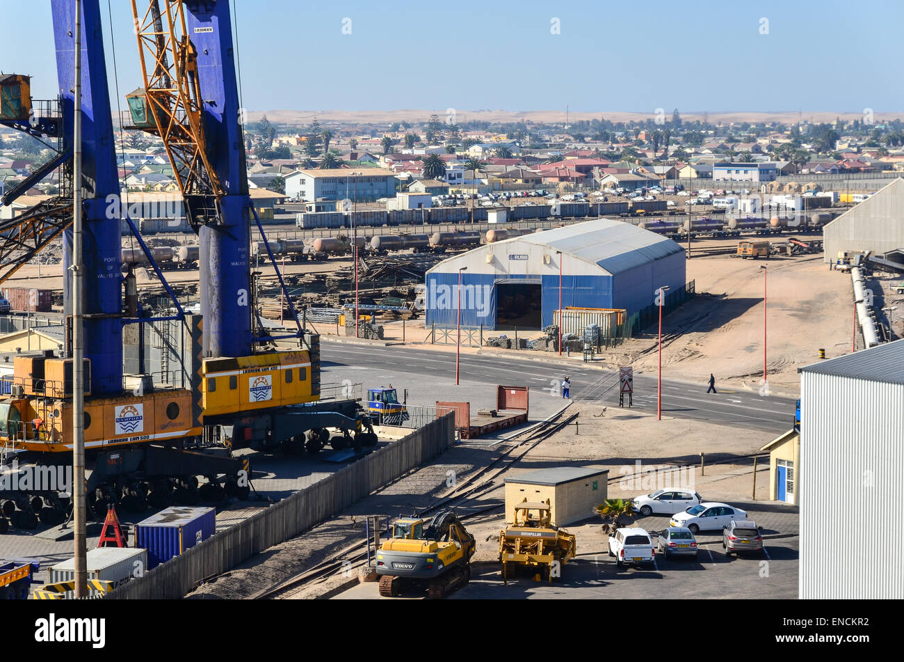 Cranes of the general cargo terminal and city of Walvis Bay, Namibia - Stock Image