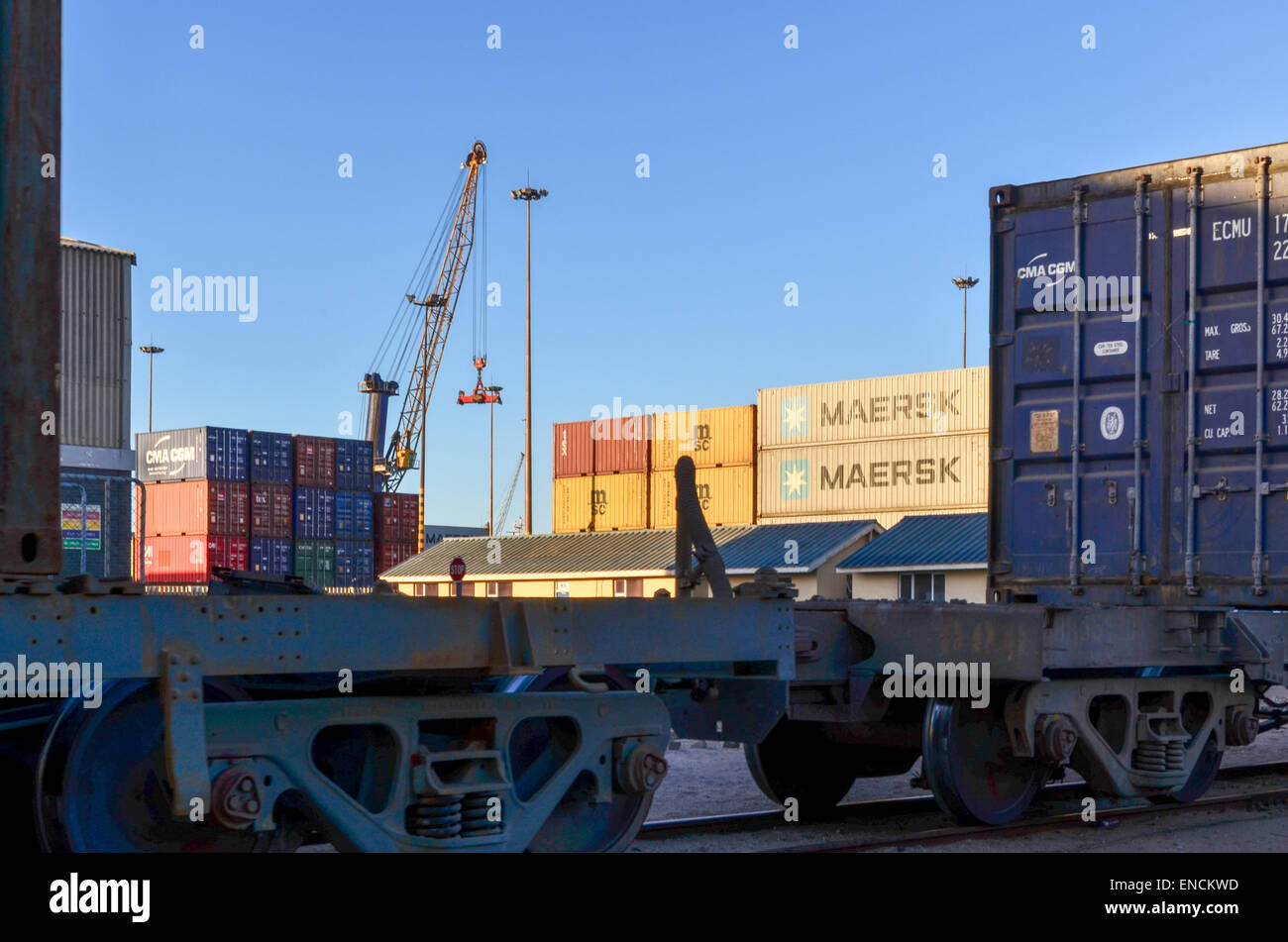 Maersk and MSC containers at the container terminal of the port of Walvis Bay, Namibia, behind a freight train - Stock Image