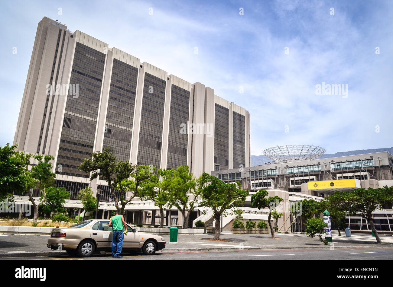 Civic centre, in the city center of Cape Town, South Africa, and a taxi - Stock Image