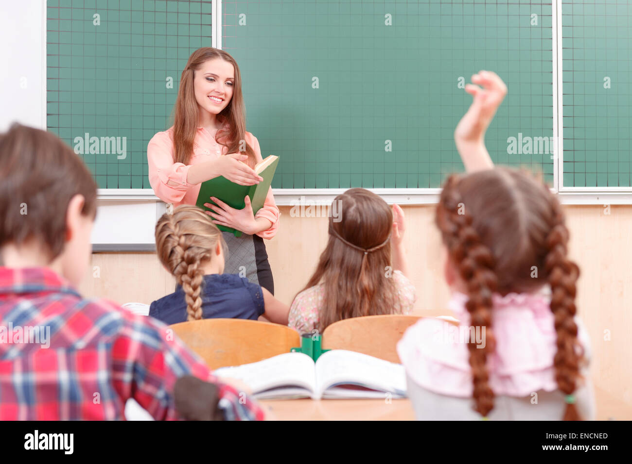 Pupils raising their hands during classes Stock Photo