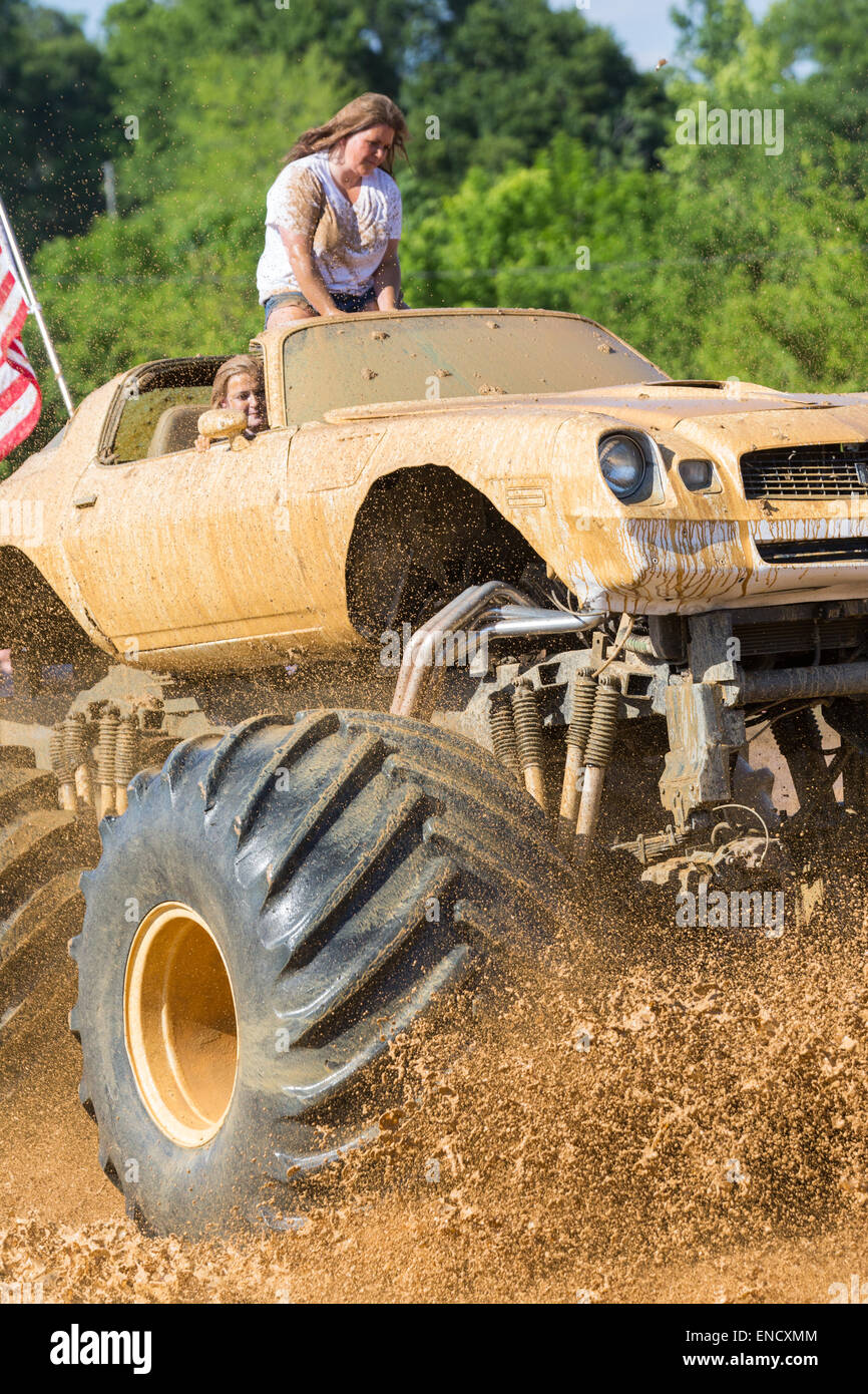 A Monster Truck Outfitted With Special Tires Rides Through A Pool Of Stock Photo Alamy