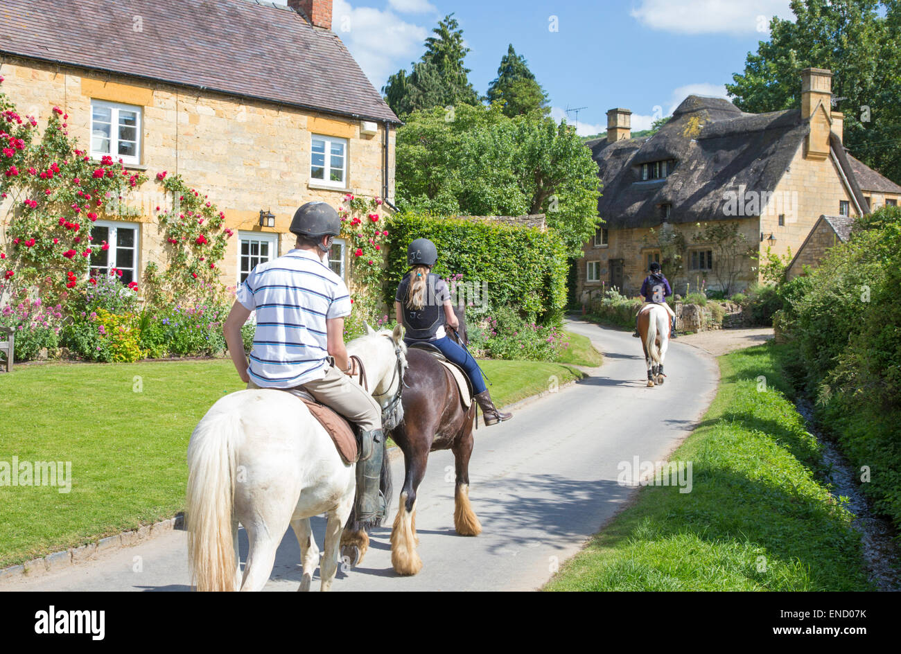 Horse riding in the Cotswold village of Stanton, Gloucestershire, England, UK - Stock Image