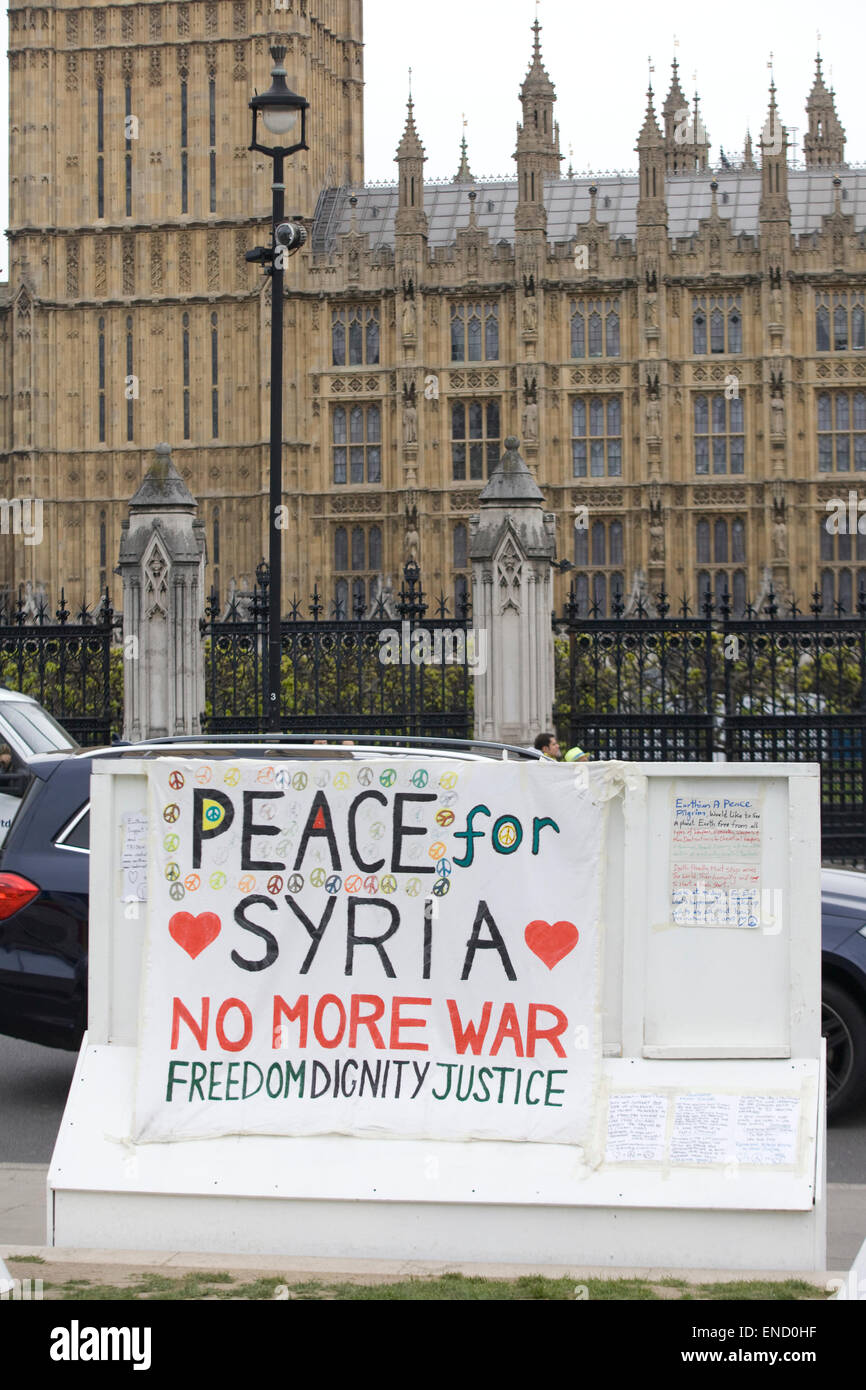 Peace for Syria protest outside the house of parliament London - Stock Image