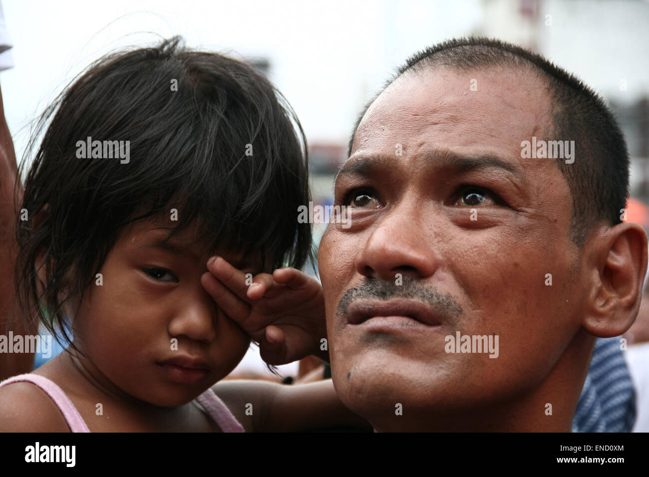 Manila, Philippines. 03rd May, 2015. A Manny Pacquiao fan and a young girl are teary eyed while watching the fight - Stock Image