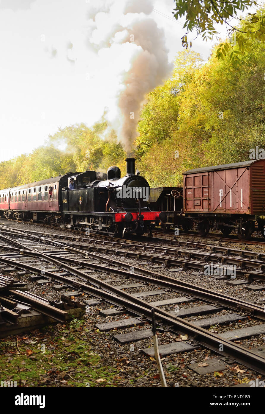 LMS Class 3F 0-6-0 tank engine No 47406 leaving Bitton station. - Stock Image
