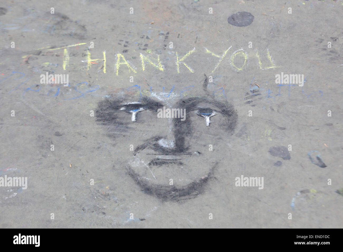 Thank you written in Chalk with a crying face - Stock Image