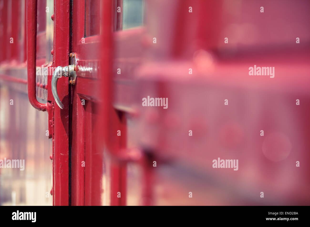 Detail of red closed nostalgic vintage railway car door - Stock Image