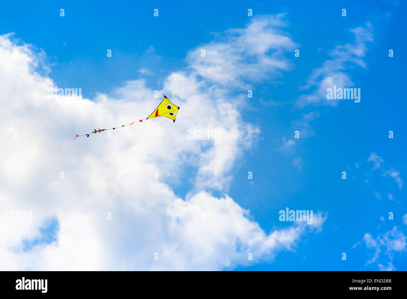 The Kite at the Sky - Colorful kite is flying at the summery sky Stock Photo
