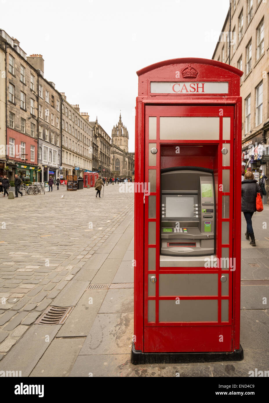 Traditional red telephone box adapted into an electronic cash machine on the Royal Mile, Edinburgh, Scotland, UK - Stock Image