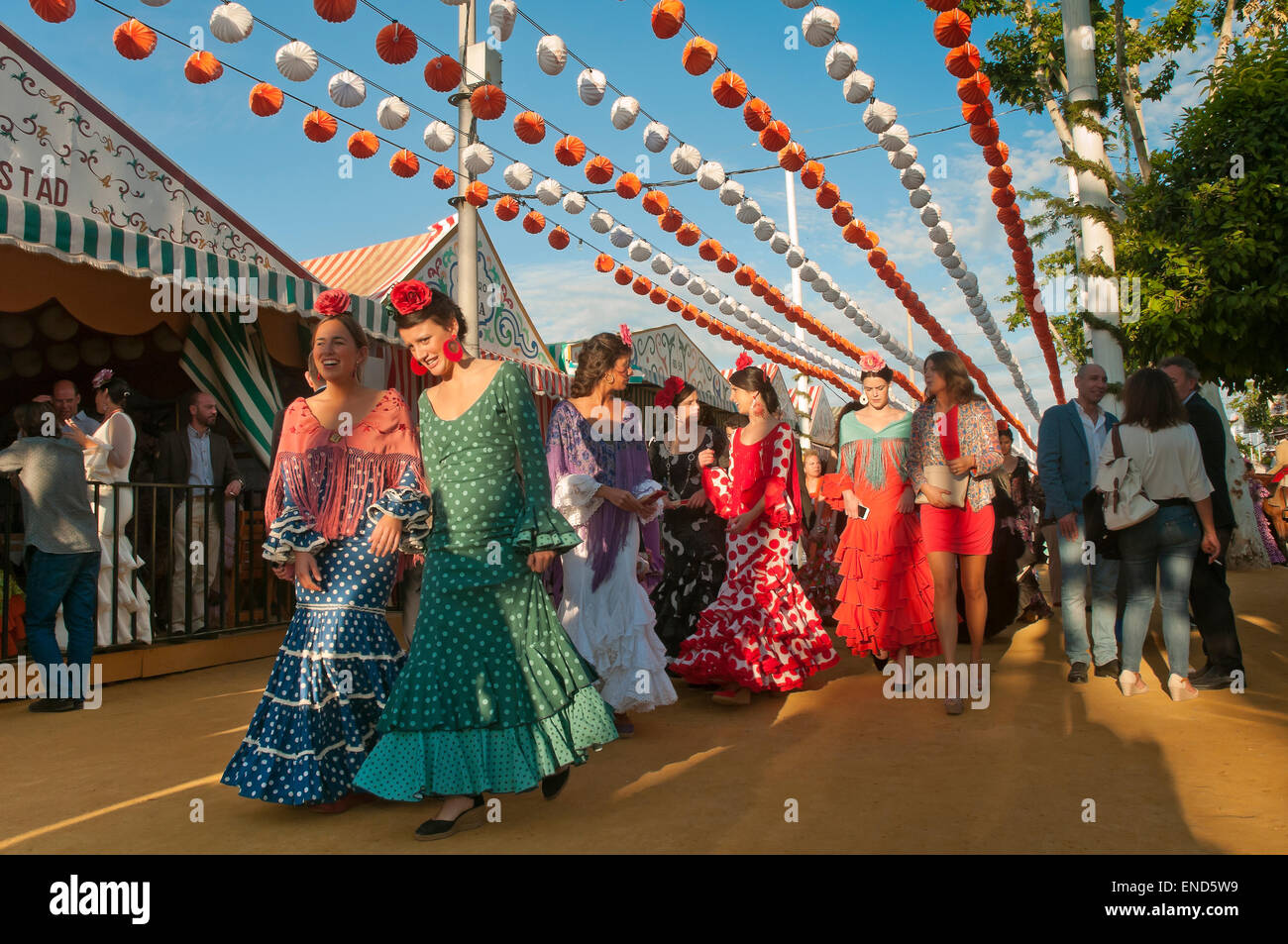 April Fair, Women wearing a traditional flamenco dress, Seville, Region of Andalusia, Spain, Europe - Stock Image
