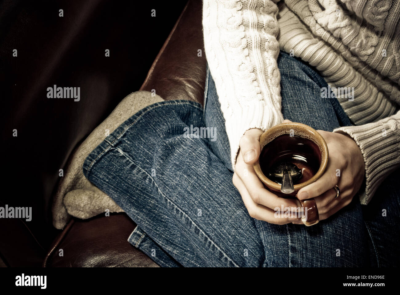 Girl holding a cup of tea - Stock Image