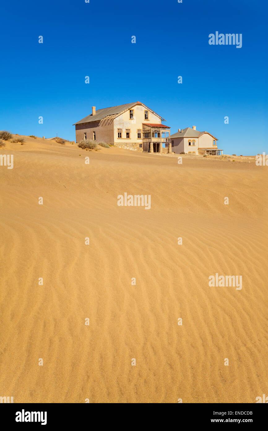 Deserted houses in Kolmanskop, a former diamond town in Namibia. - Stock Image