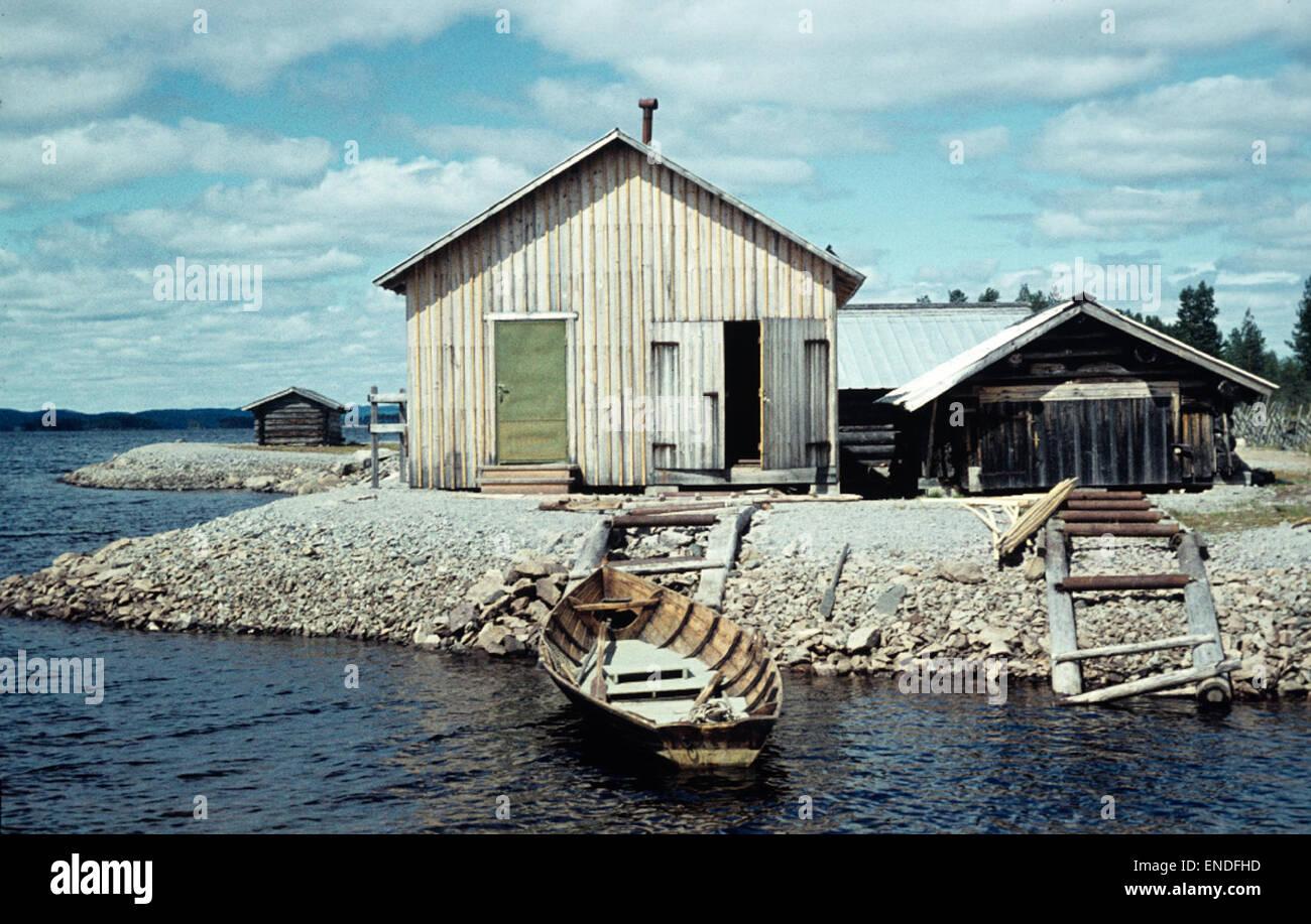 Boathouses by lake Tisjön, Dalarna, Sweden - Stock Image