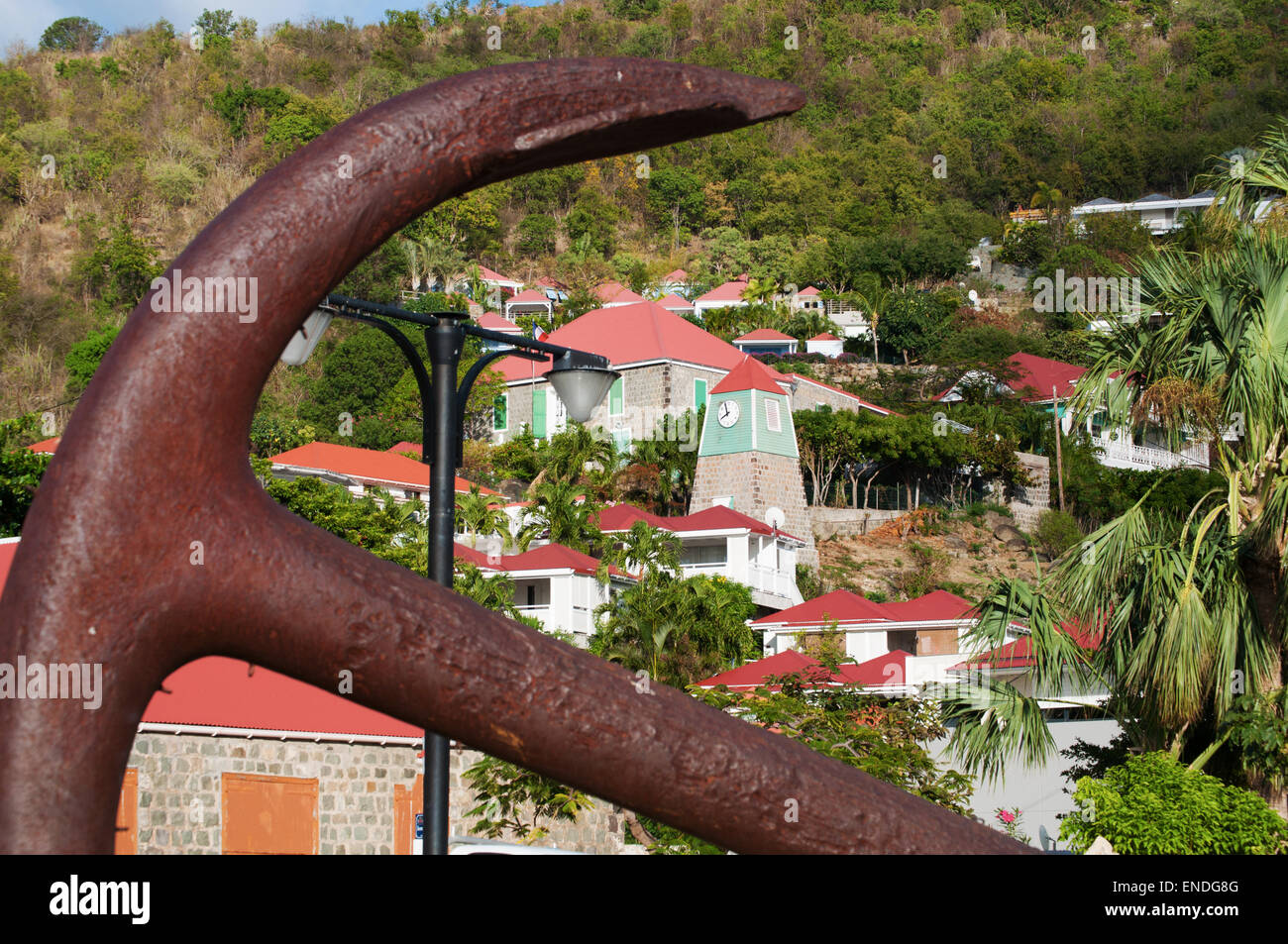 St. Barths, Saint-Barthélemy, French West Indies, Caribbean: an anchor in the center of Gustavia and the Swedish Clock Tower and Belfry Stock Photo