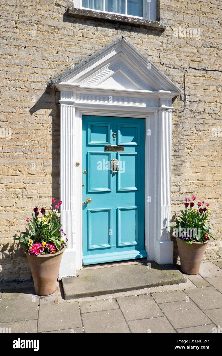 A turquoise Georgian 6 panel front door set in an ornate architectural surround - Stock Image