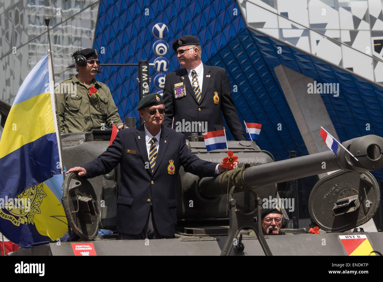 TORONTO, CANADA - MAY 2, 2015: Military parade takes place in the street. People celebrate the 70th anniversary - Stock Image