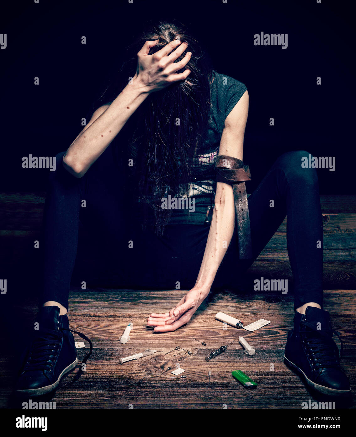 Grunge cross vintage filtered photo of a woman posing as drug addict, concept photo. - Stock Image