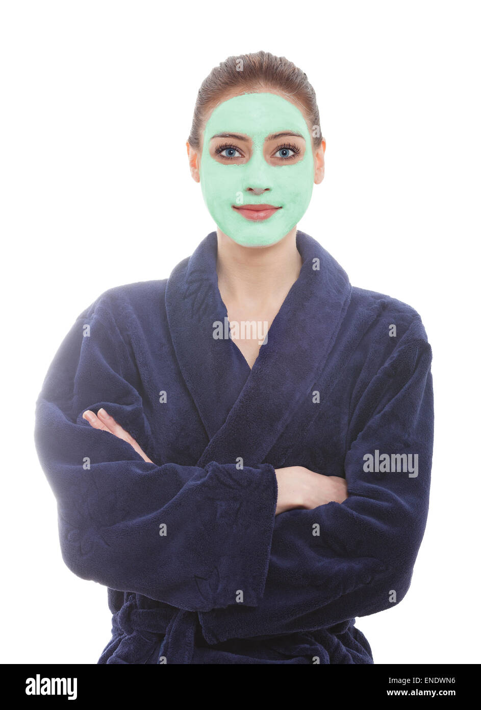 Young woman wearing dressing gown with facial mask, spa and beauty concept. - Stock Image