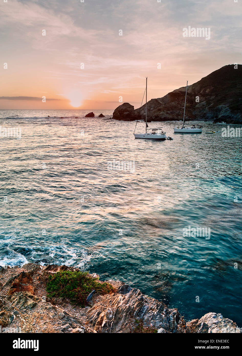 Two sailboats anchored at  cove called Little Harbor on Catalina Island at sunset. - Stock Image