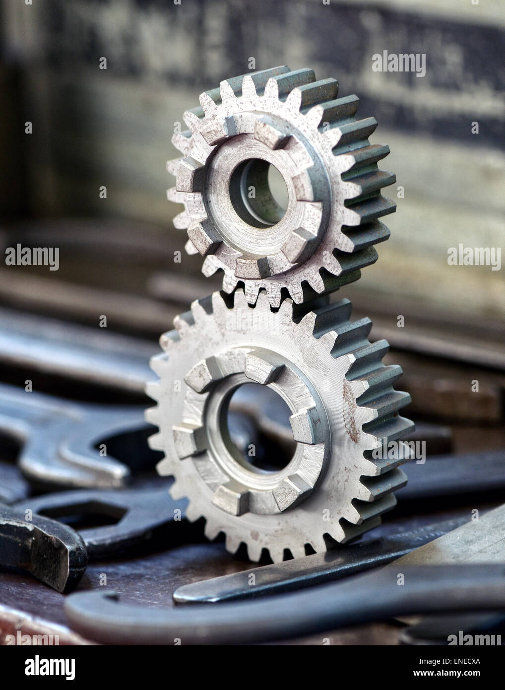 Two newly machined interlocking toothed gears - Stock Image