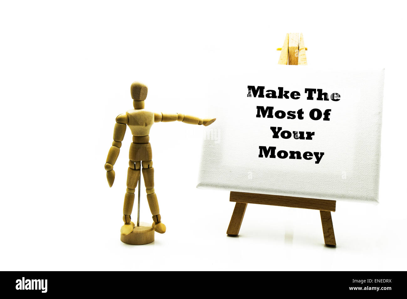 Wooden man with white board pointing at words 'make the most of your money' invest save investment investments - Stock Image