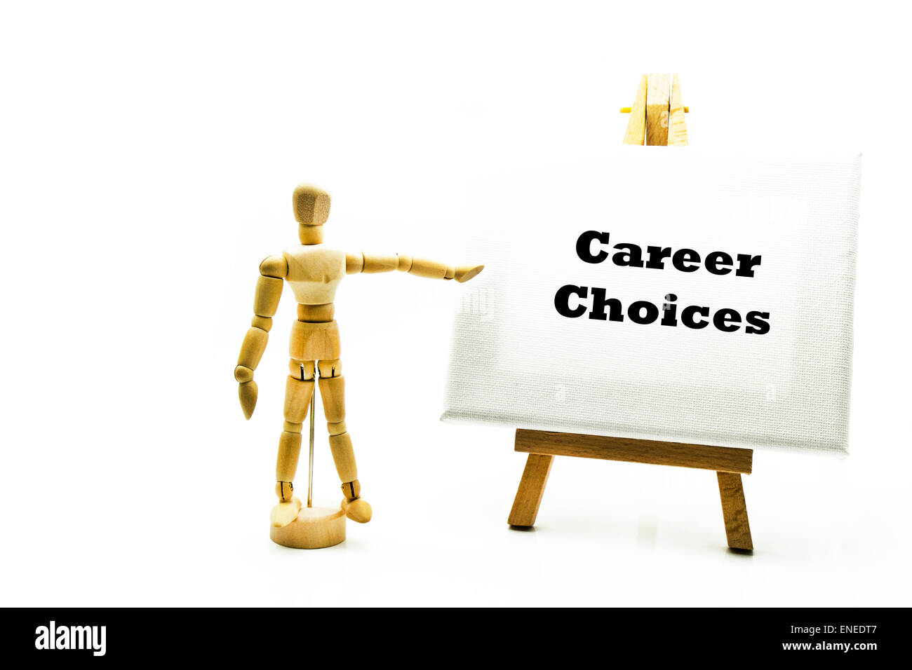 Wooden man with white board pointing at words 'career choices' future work choice choose careers pick choosing - Stock Image