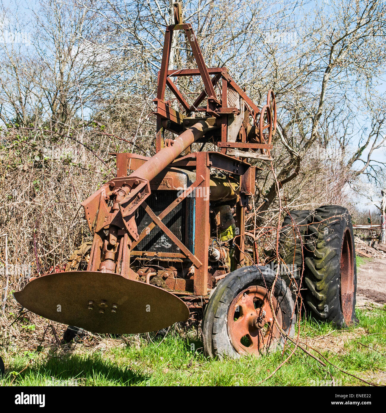 Old rusty Fordson Major tractor with a brush cutter
