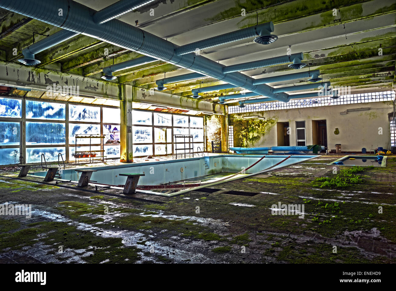 old abandoned swimming pool in HDR - Stock Image