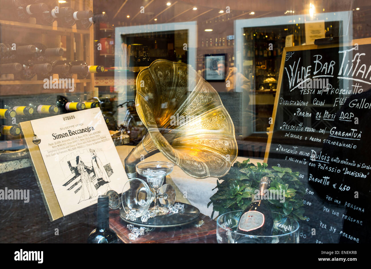 Parma, alcohol and opera music in a wine bar window - Stock Image