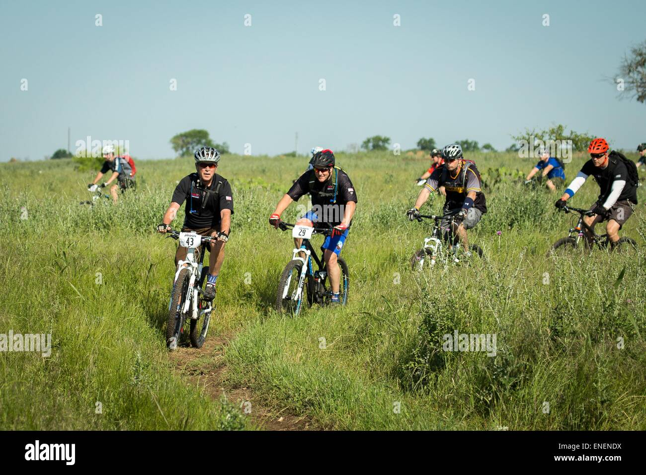 Former U.S. President George W. Bush (right) leads military service members on the W100K mountain bike ride across - Stock Image
